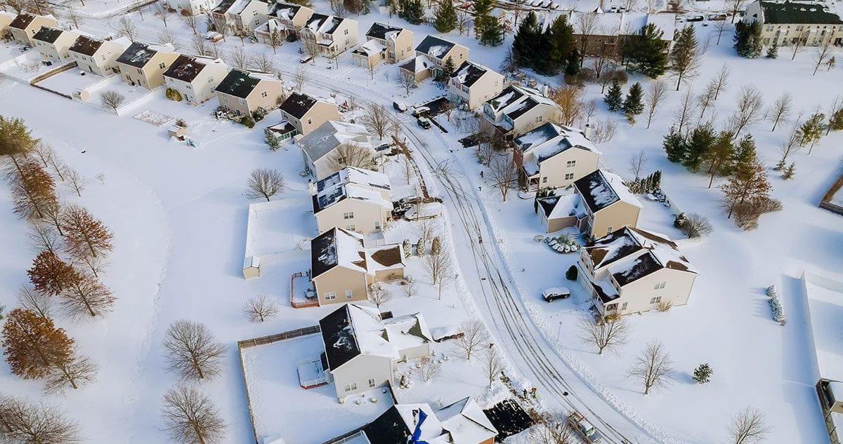 Winter snow covering neighborhood